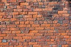 Eine verschlechternde alte Backsteinmauer konnte Gebrauch ein Hintergrund sein oder wie Stockfotografie