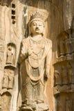 Eine vollkommene Buddha-Statue im Longmen Groottoes Lizenzfreie Stockfotos