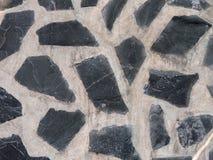 Eine Wand des dekorativen Steins und des Betons Lizenzfreies Stockfoto