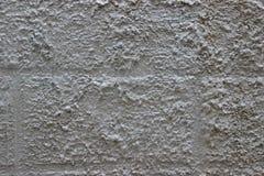 Eine Wand mit dekorativem plasterwork Stockbild