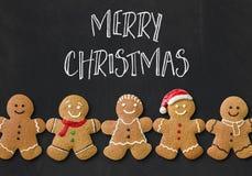 Eine Weihnachtskarte mit Lebkuchenmännern Lizenzfreies Stockbild