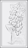 Eine Weintraube und ein Glas Wein Stockfotografie