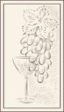 Eine Weintraube und ein Glas Wein Stockfoto