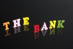 Eine Wort Bank auf einem schwarzen Hintergrund stockfotos