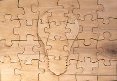 Eine Zahl gemacht von der hölzernen Puzzlespiellampe Lizenzfreies Stockbild
