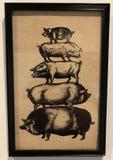 Eine Zeichnung von fünf Schweine angehäuft auf einander Stockbild