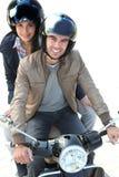 Einen Roller zusammen reiten Stockfotos