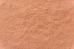 Einfache blasse orange Wand Lizenzfreie Stockfotos