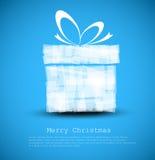 Einfache blaue Weihnachtskarte mit einem Geschenk Lizenzfreie Stockfotos
