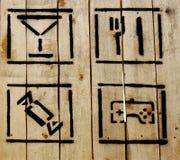 Einfache Ikonen auf hölzernem Hintergrund Lizenzfreies Stockbild
