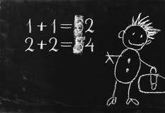 Einfache Matheoperation auf Tafel. Stockbilder