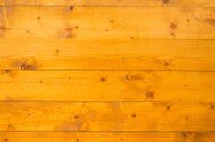 Einfache orange hölzerne Wand Lizenzfreie Stockfotografie
