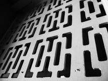 Einfarbige abstrakte Formen in der Block-Wand Stockfotos