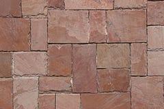 Einfarbiger geometrischer Hintergrund von Steinen Stockfotos