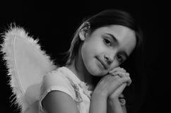 Einfarbiges Porträt des Engelchens Stockbild