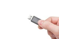 Einfluss der USB-grellen Karte in der Hand. Getrennt. Stockbild