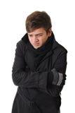 Einfrierender Mann mit Winterkleidung Lizenzfreies Stockfoto
