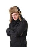 Einfrierender Mann mit Winterkleidung Stockbild