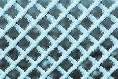 Einfrierendes Zaunmuster Stockfoto