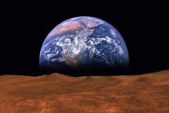 Eingebildete Ansicht von Erde steigend vom Horizont der Anlage Mars Lizenzfreie Stockfotos