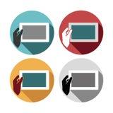 Eingestellte Ikonen des Tablets in der Hand Stockfotos