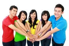 Einheit mit ihren Händen zusammen Stockbilder
