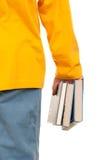 Einige Bücher in der Hand Stockfoto