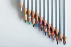 Einige farbige Bleistifte auf dem Papier Lizenzfreies Stockbild