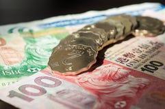 Einige Hong Kong-Banknoten und -münzen Stockfotos