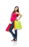 Einkaufen der schwangeren Frau lokalisiert auf Weiß Lizenzfreie Stockbilder