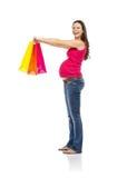Einkaufen der schwangeren Frau lokalisiert auf Weiß Stockfotografie