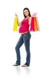 Einkaufen der schwangeren Frau lokalisiert auf Weiß Lizenzfreies Stockbild