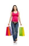 Einkaufen der schwangeren Frau lokalisiert auf Weiß Lizenzfreie Stockfotografie