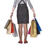 Einkaufenbeutel und -fahrwerkbeine Stockfoto
