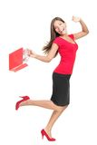 Einkaufenfrau in laufendem Holdingbeutel der Freude Lizenzfreies Stockbild