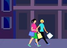 Einkaufenfrauen in der Stadt Stockfoto
