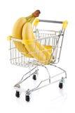 Einkaufenlaufkatze und -bananen Stockfotografie