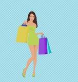 Einkaufenmädchen mit Beuteln Stockfotografie
