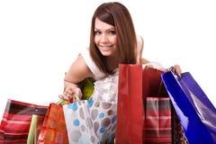 Einkaufenmädchen mit Gruppenbeutel. Lizenzfreies Stockfoto