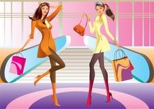 Einkaufenmädchen mit zwei Art und Weise mit Beutel im Mall Lizenzfreies Stockbild
