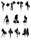 Einkaufsfamilie und Mädchenschattenbilder. Lizenzfreies Stockbild
