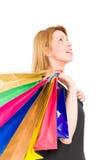 Einkaufsfrau, die oben schaut Stockbilder