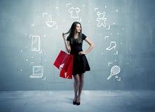 Einkaufsfrau mit Taschen und gezogenen Ikonen Lizenzfreie Stockfotografie
