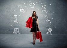 Einkaufsfrau mit Taschen und gezogenen Ikonen Lizenzfreie Stockfotos