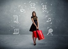 Einkaufsfrau mit Taschen und gezogenen Ikonen Stockbild