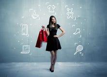 Einkaufsfrau mit Taschen und gezogenen Ikonen Lizenzfreies Stockfoto