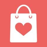 Einkaufstasche mit Form der Herzikone Stockbild