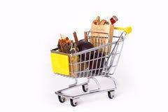 Einkaufswagen mit Beuteln Stockfotos