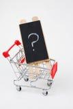 Einkaufswagen mit Frage Stockfoto