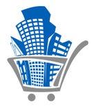 Einkaufswagen mit Gebäuden Stockbild